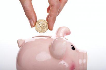 Coin put into piggy bank